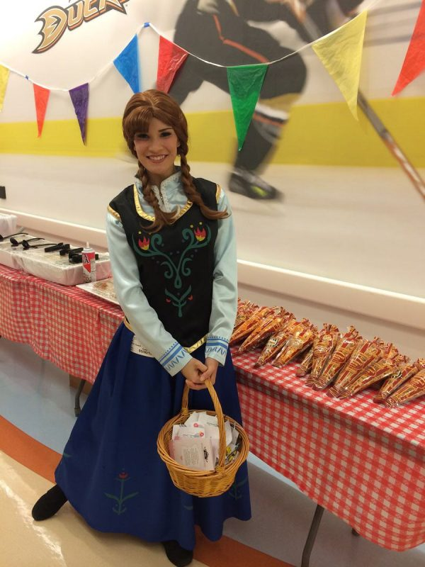 Princess Anna helping out at a local event