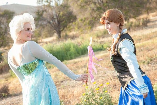 Elsa giving Anna a wand