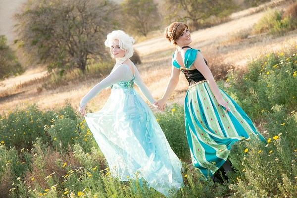 Anna and Elsa in coronation dresses